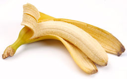 Ripe bananas and one half cleared Royalty Free Stock Photo