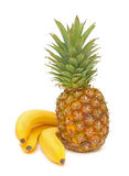 Ripe bananas and pineapple on a white background Royalty Free Stock Images