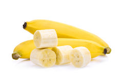 Ripe bananas with slice isolated on white Stock Images