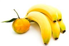 Ripe bananas and tangerine Stock Photos