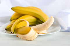 Ripe bananas on white table royalty free stock photography
