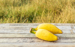 Ripe bananas on the wooden table outdoors Royalty Free Stock Photos