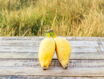 Ripe bananas on the wooden table outdoors Royalty Free Stock Photo