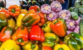 Ripe beautiful vegetables, onions, peppers, cucumber on the counter in the market royalty free stock images