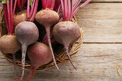 Ripe beets in basket. Fresh and ripe beets in basket on wooden table stock photography