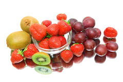 Ripe Berries and fruits on a white background with reflection Royalty Free Stock Images