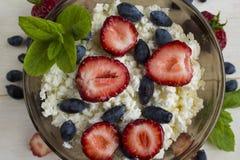 With ripe berries of honeysuckle, strawberry Stock Photo