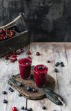 Ripe berries and organic fruit smoothie. On wooden background stock photo