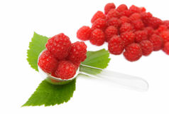 Ripe berries of raspberry with leaves. Isolated on white background Royalty Free Stock Photo