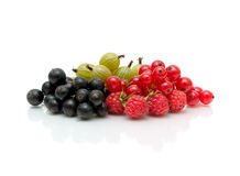 Ripe berries of red and black currant and gooseberries on a whit Royalty Free Stock Image