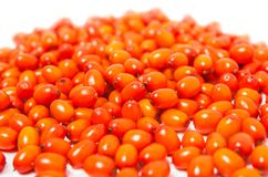 Ripe berries of sea buckthorn scattering. On white background Royalty Free Stock Image