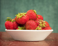 Ripe berries of strawberry in plate on table Royalty Free Stock Photos