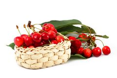 Ripe berries of a sweet cherry in a basket with a Royalty Free Stock Photos