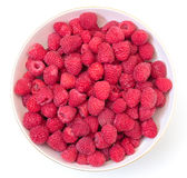 Ripe Berry Red Raspberry in Bowl. On white background, top view Royalty Free Stock Image