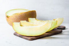 Ripe big and yellow melon. Cut into pieces. Appetizing background. Healthy food. Stock Photos
