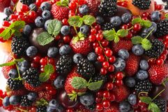 Ripe blackberries, blackberries, strawberries, red currants, peaches and plums. Mix berries and fruits. Top view. Background berri. Es. Various fresh summer stock image