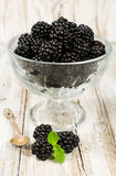 Ripe blackberries in a glass vase Stock Images
