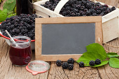 Ripe blackberries and a jar blackberry jelly Stock Image