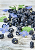 Ripe blackberries on a wooden Royalty Free Stock Images