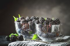 Ripe blackberry on a wooden table. Dark background. Selective focus. Background with copy space stock images