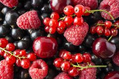 Ripe blackcurrants, cherries, red currants, raspberries. Mix berries and fruits. Top view. Background berries and fruits. Various fresh summer fruits Royalty Free Stock Images