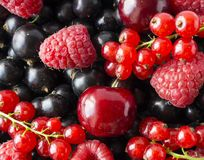 Ripe blackcurrants, cherries, red currants, raspberries. Mix berries and fruits. Top view. Background berries and fruits. Various fresh summer fruits stock photography