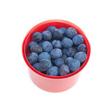 Ripe blue plums in red bucket isolated Stock Photo