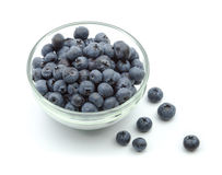 Ripe blueberries in bowl isolated on white Stock Images