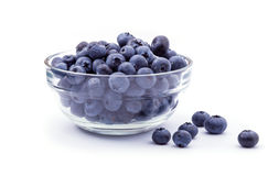 Ripe blueberries in bowl isolated on white Stock Photography