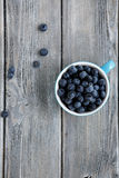 Ripe blueberries in the cup Royalty Free Stock Photo