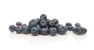 Ripe blueberries on a white background with reflection Royalty Free Stock Photos