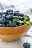 Ripe blueberries in a wooden bowl. Royalty Free Stock Photos