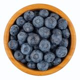Ripe blueberries in wooden bowl. stock image