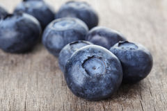 Ripe blueberries on wooden table Royalty Free Stock Photos