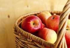 Ripe bright apples in a basket Stock Image