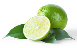 Ripe bright lime with leaves. Isolated on white background Royalty Free Stock Images