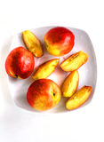 Ripe bright nectarines on a white saucer. Ripe bright nectarines, on a white saucer royalty free stock images