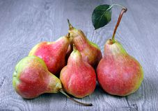 Ripe bright red pears on a wooden table. Close up Royalty Free Stock Images