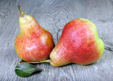 Ripe bright red pears on a wooden table. Close up Royalty Free Stock Photos