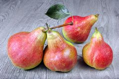 Ripe bright red pears on a wooden table. Close up Stock Photo