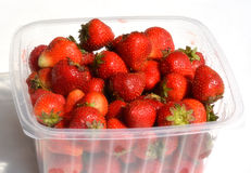 Ripe bright red ripe strawberries in a plastic package. Ripe bright red ripe strawberries , Ripe bright red ripe strawberries Stock Photo