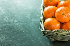 Ripe Bright Tangerines in Wicker Basket on Dark Background Harvest Winter Holiday Concept Christmas New Years Stock Photos