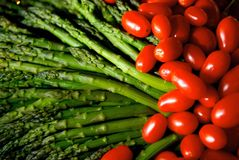 Ripe brightly colored asparagus and tomatoes Royalty Free Stock Images