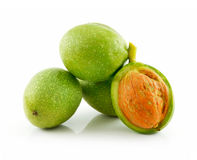 Ripe Broken Walnuts with Green Leaves Isolated Stock Image