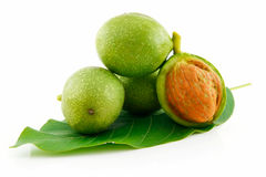 Ripe Broken Walnuts with Green Leaves Isolated Royalty Free Stock Images