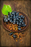 Ripe bunch of grapes and raisins Stock Images