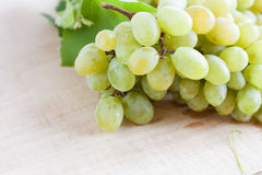 Ripe bunches of grapes wooden surface Stock Photo