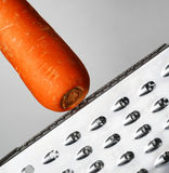 Ripe carrot rubbing on a grater Stock Photo