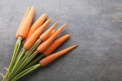 Ripe carrots. Fresh and ripe carrots on grey wooden table Stock Images