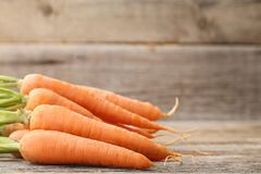 Ripe carrots. Fresh and ripe carrots on wooden table Stock Photos
